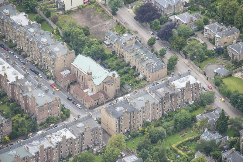 Oblique aerial view of St Peter's Roman Catholic Church and Presbytery, looking WNW.