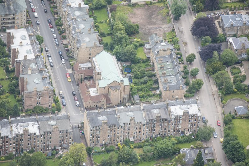 Oblique aerial view of St Peter's Roman Catholic Church and Presbytery, looking W.