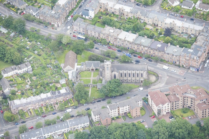 Oblique aerial view of Reid Memorial Church and Church Officer's House, looking S.