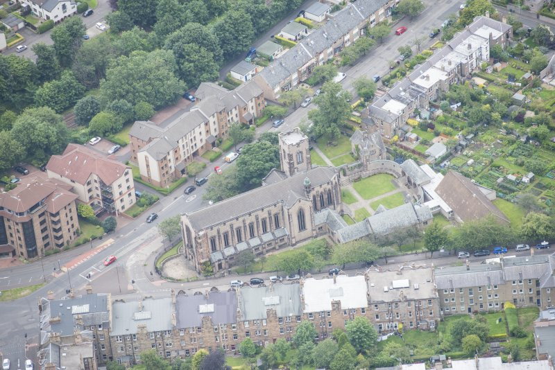 Oblique aerial view of Reid Memorial Church and Church Officer's House, looking NNE.