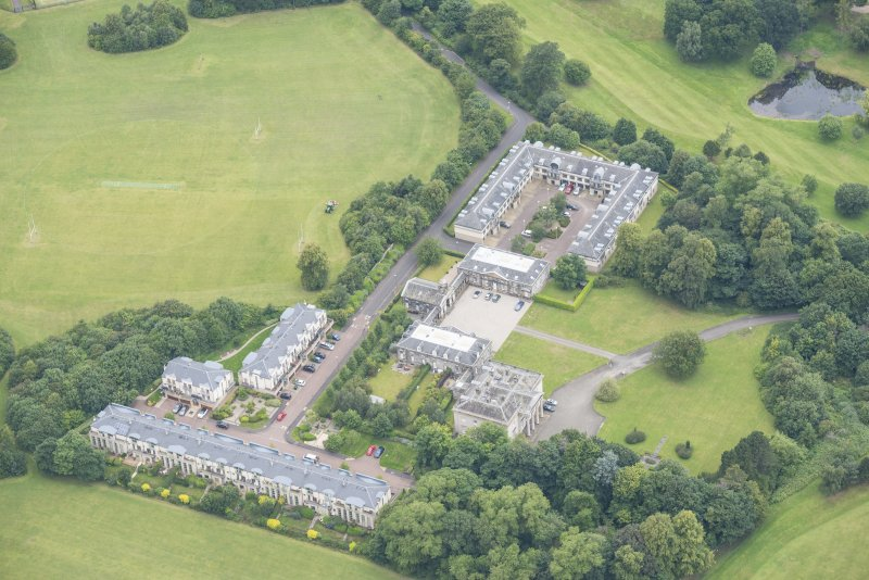 Oblique aerial view of Duddingston House, Offices and Stables, looking NNW.