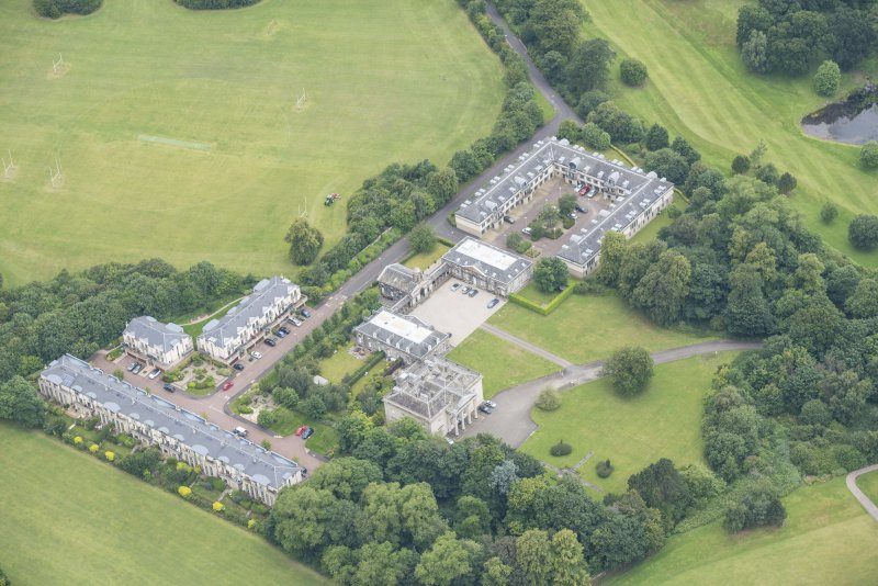 Oblique aerial view of Duddingston House, Offices and Stables, looking NW.