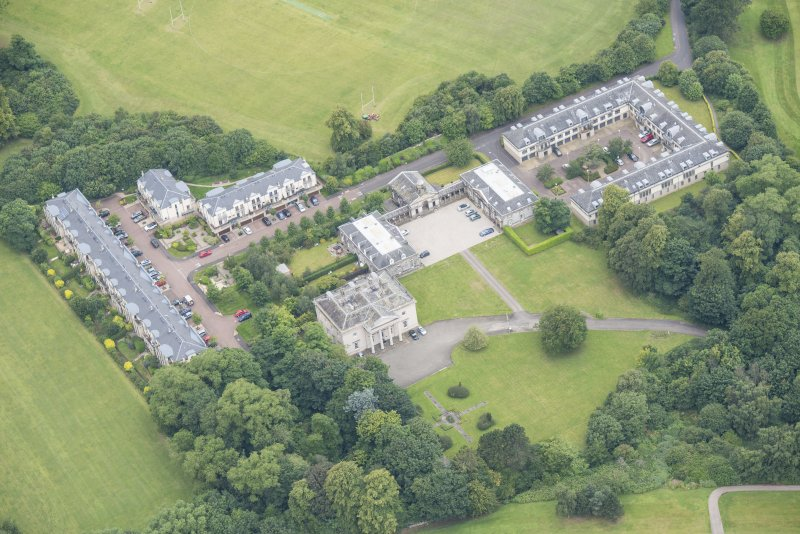 Oblique aerial view of Duddingston House, Offices and Stables, looking WNW.