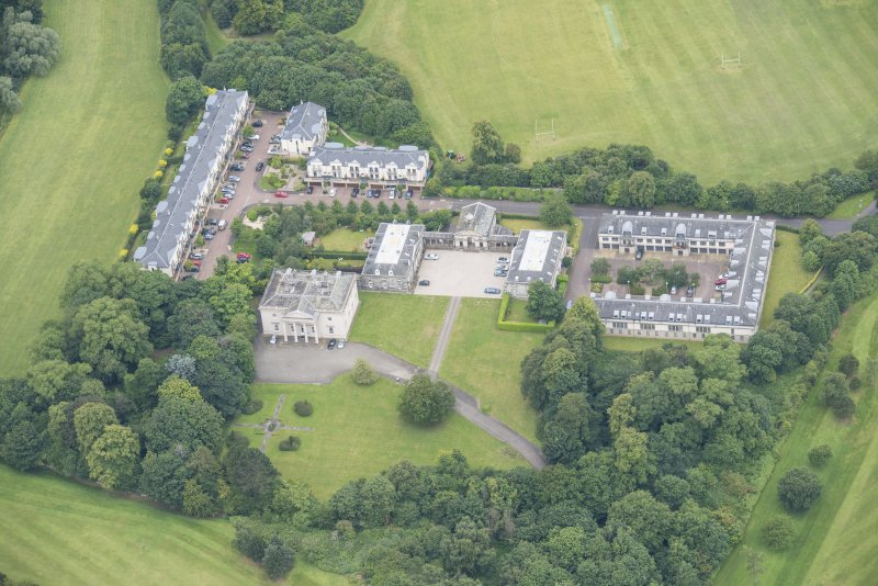 Oblique aerial view of Duddingston House, Offices and Stables, looking WSW.