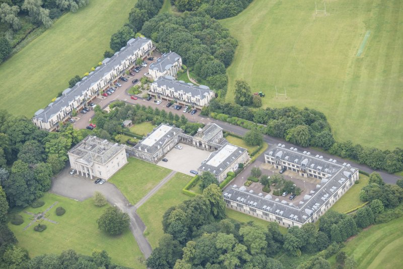 Oblique aerial view of Duddingston House, Offices and Stables, looking SW.