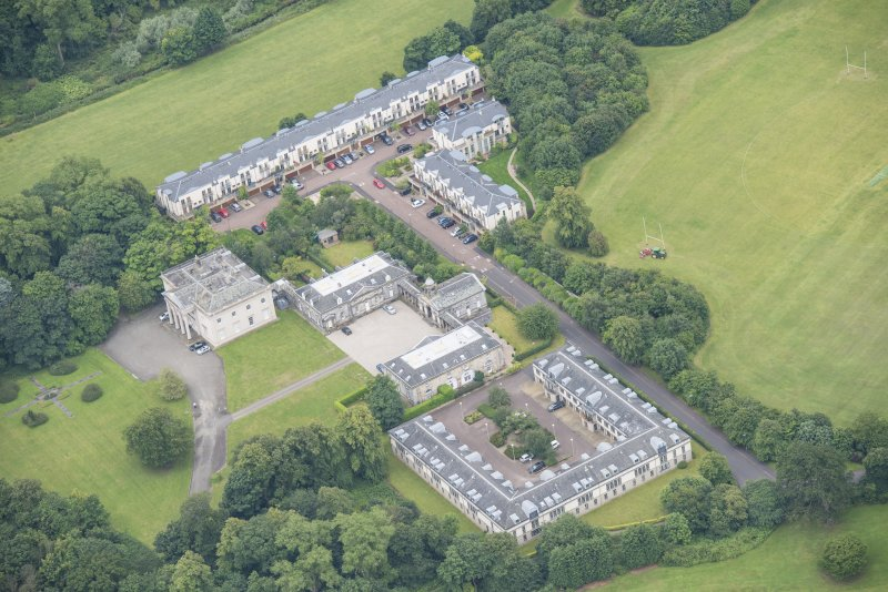 Oblique aerial view of Duddingston House, Offices and Stables, looking SSW.