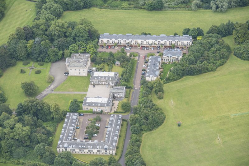 Oblique aerial view of Duddingston House, Offices and Stables, looking S.