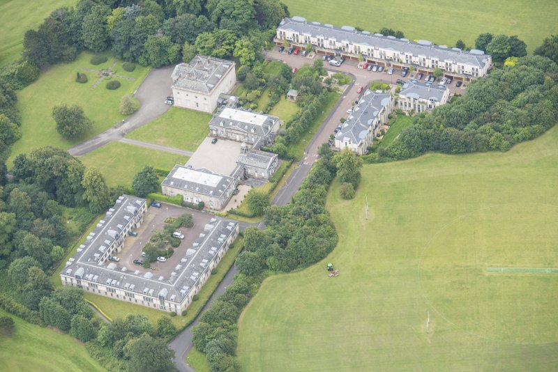 Oblique aerial view of Duddingston House, Offices and Stables, looking SSE.