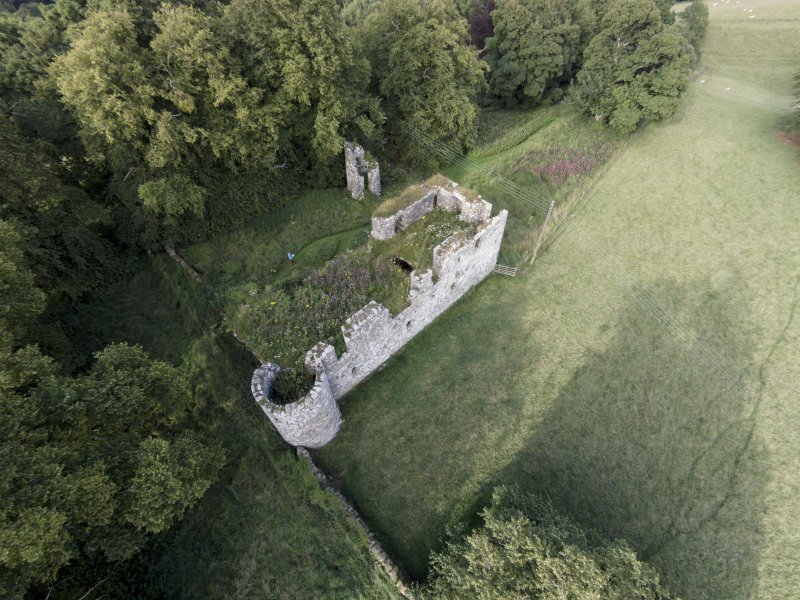 Oblique aerial view of Dowhill Castle looking ENE.