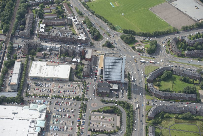 Oblique aerial view of Anniesland Court, looking SSW.
