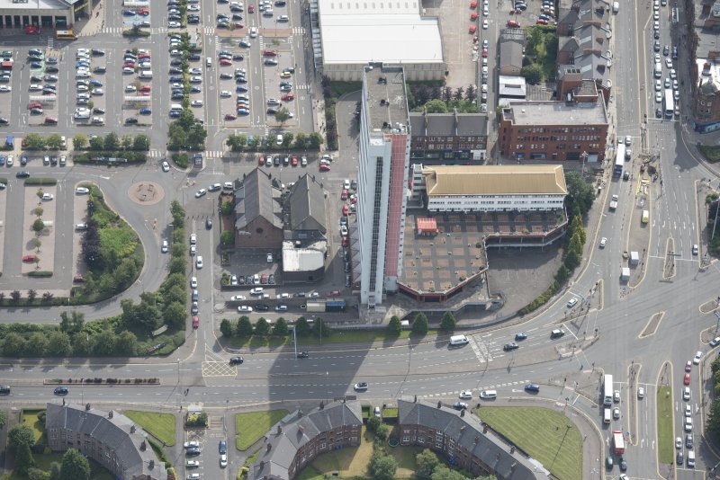 Oblique aerial view of Anniesland Court, looking SE.