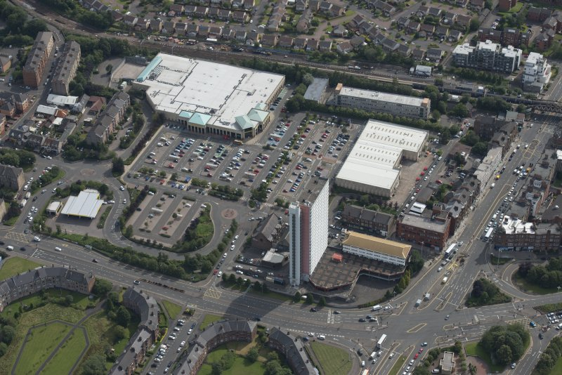 Oblique aerial view of Anniesland Court and shopping centre, looking ESE.