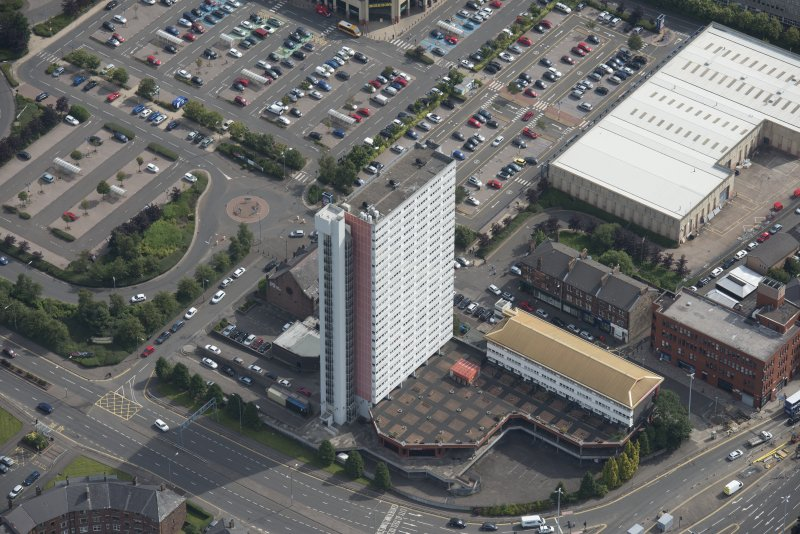 Oblique aerial view of Anniesland Court, looking E.
