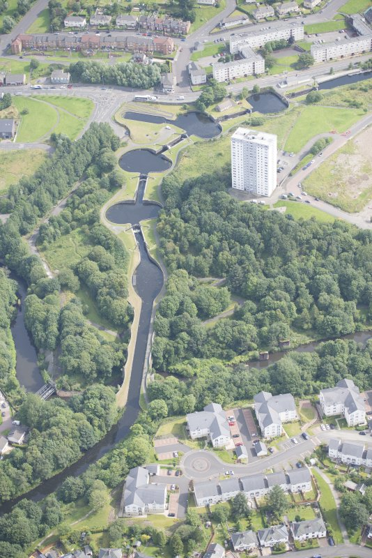 Oblique aerial view of the Kelvin Aqueduct and Maryhill Locks, looking ENE.