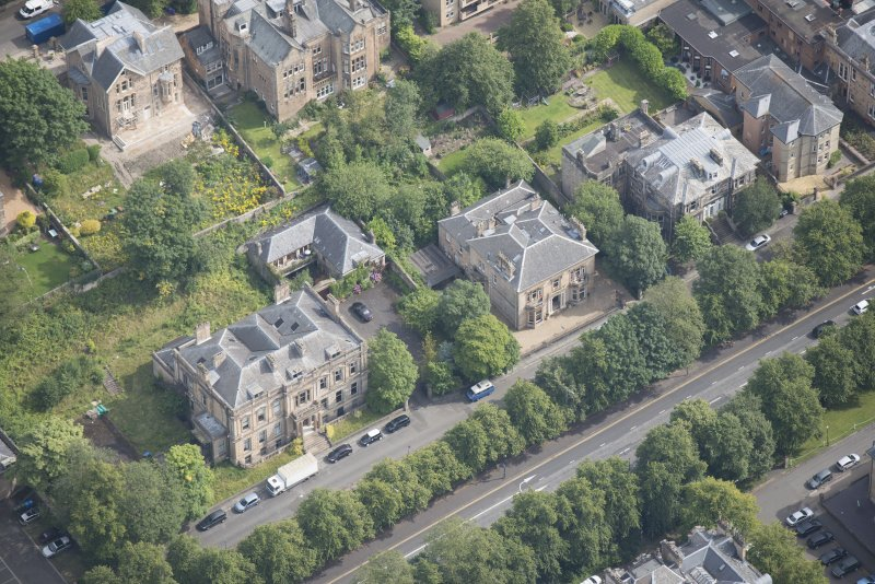 Oblique aerial view of Carlston Club, Carlston Club garage and 10 Cleveden Gardens, looking NE.