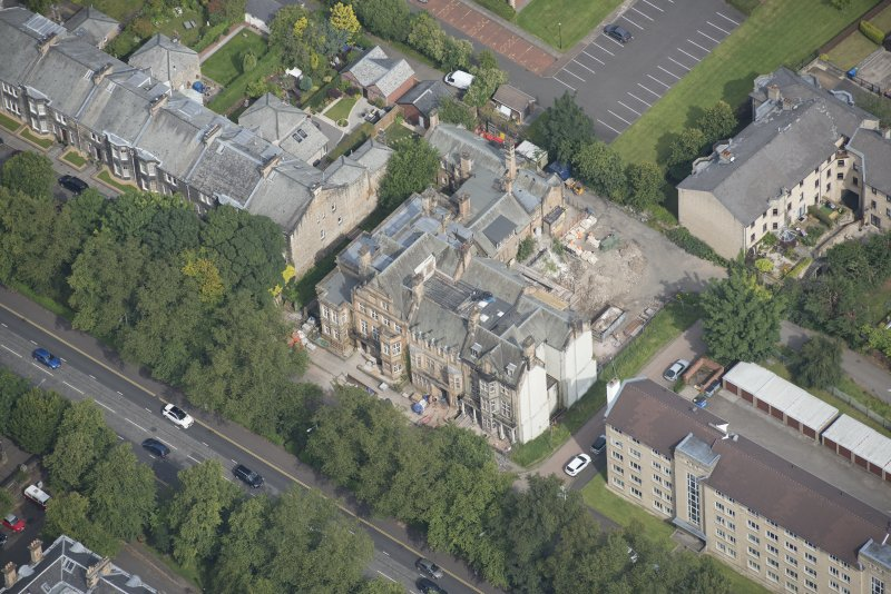 Oblique aerial view of 9 and 10 Lowther Terrace, looking N.