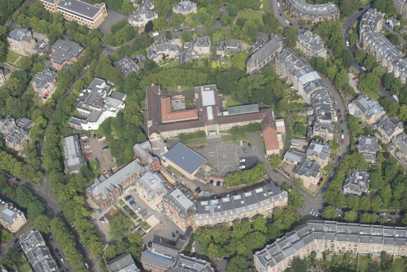 Oblique aerial view of Notre Dame School, looking NNW.