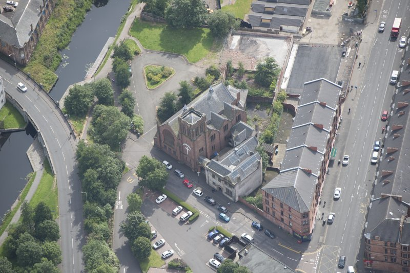 Oblique aerial view of Ruchill Parish Church and Ruchill Parish Church Hall and Janitor's House, looking ESE.