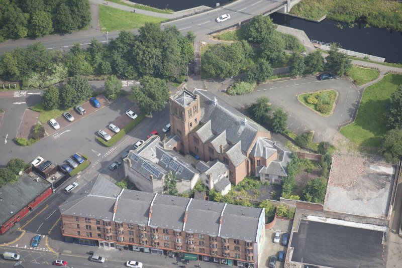 Oblique aerial view of Ruchill Parish Church and Ruchill Parish Church Hall and Janitor's House, looking NNE.