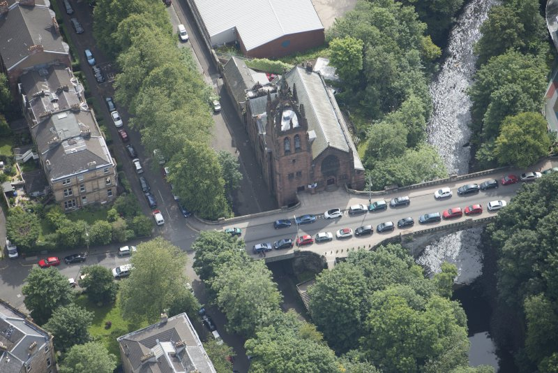Oblique aerial view of Stevenson Memorial Free Church and Caretaker's House, looking SE.