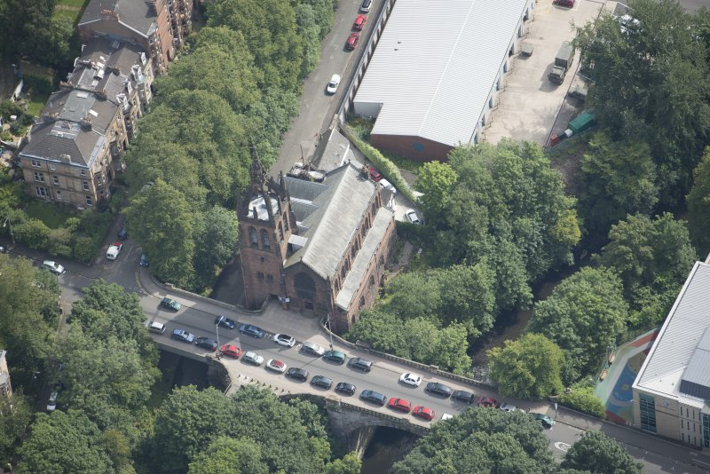 Oblique aerial view of Stevenson Memorial Free Church and Caretaker's House, looking E.