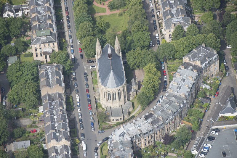Oblique aerial view of Grosvenor Terrace and Kelvinside Hillhead Parish Church, looking NW.
