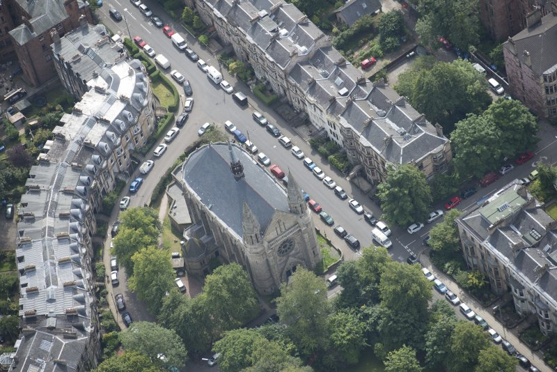 Oblique aerial view of Grosvenor Terrace and Kelvinside Hillhead Parish Church, looking SSE.