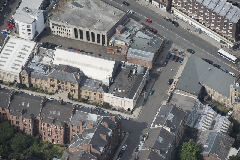 Oblique aerial view of Botanic Garden Garage and Hillhead Salon Cinema, looking WNW.