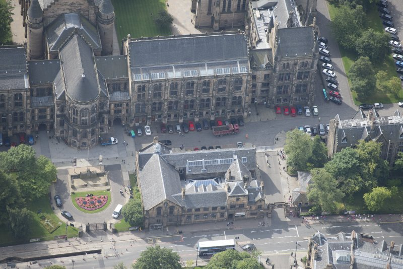 Oblique aerial view of University of Glasgow main building and Student Union, looking SSW.