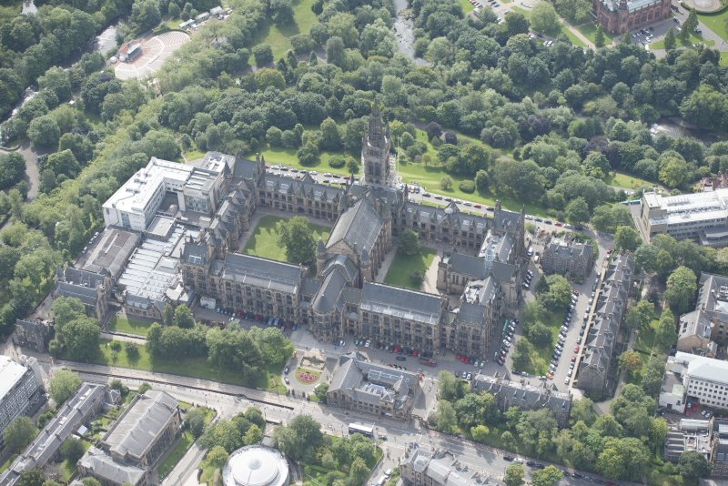 Oblique aerial view of Glasgow University, Memorial Chapel and Student's Union, looking S.
