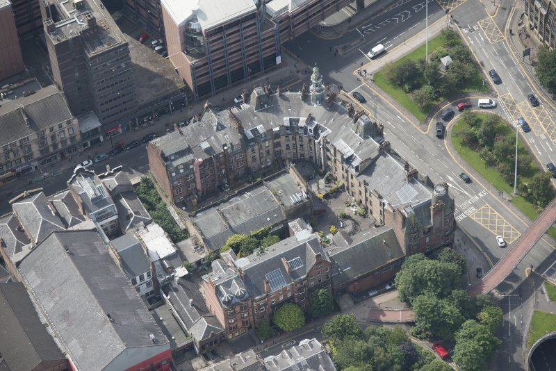 Oblique aerial view of Charing Cross Mansions, looking SW.