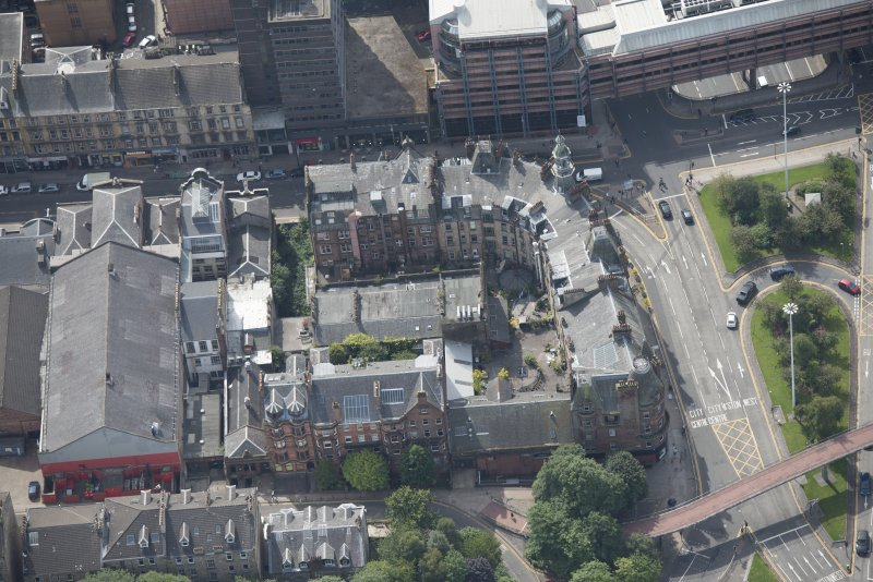 Oblique aerial view of Charing Cross Mansions, looking SSW.