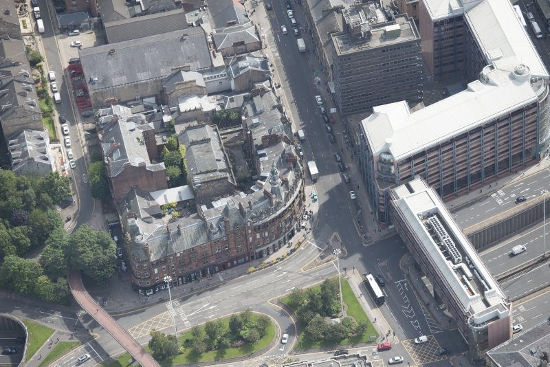 Oblique aerial view of Charing Cross Mansions, looking ESE.