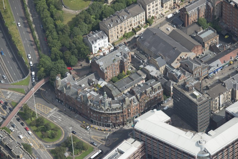 Oblique aerial view of Charing Cross Mansions, looking ENE.