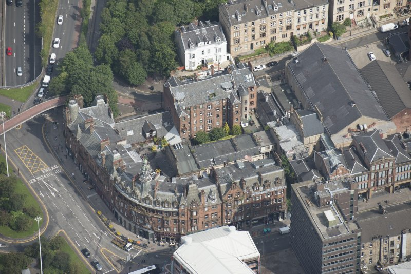 Oblique aerial view of Charing Cross Mansions, looking NE.