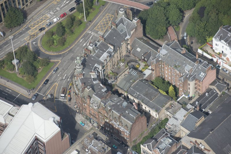 Oblique aerial view of Charing Cross Mansions, looking NW.
