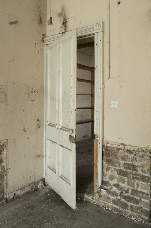 Ground floor, north east room, view of metal door to strong room