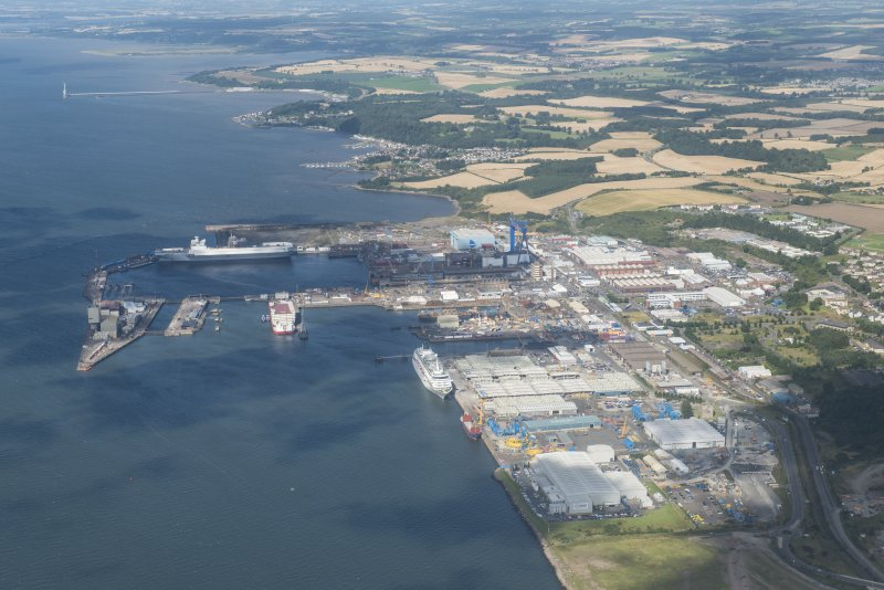Oblique aerial view of Rosyth HM Dockyard, looking WNW.