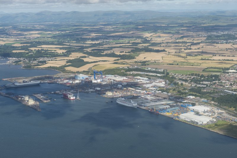 Oblique aerial view of Rosyth HM Dockyard, looking NW.