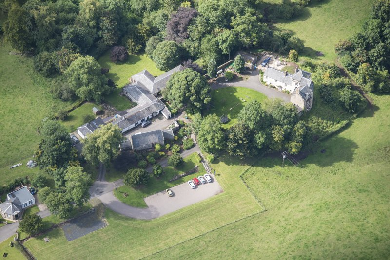 Oblique aerial view of Peel Lodge, Tower House and Stables, looking WSW.