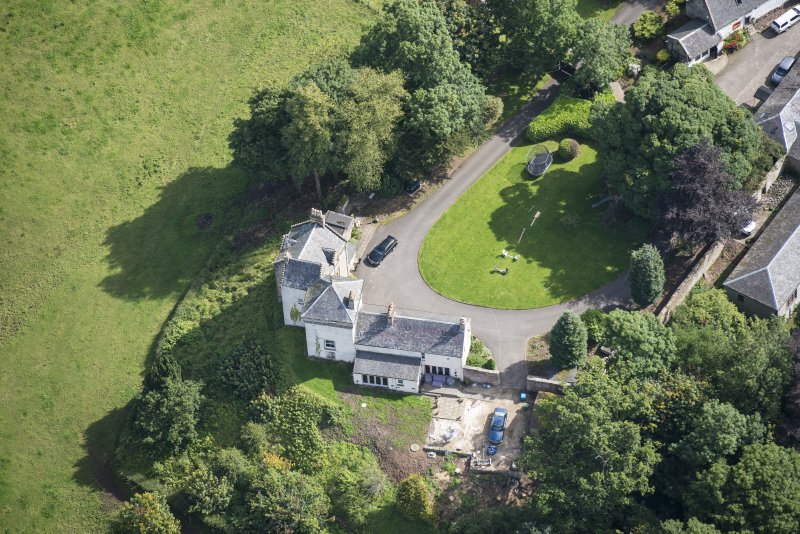 Oblique aerial view of Peel Tower House, looking E.