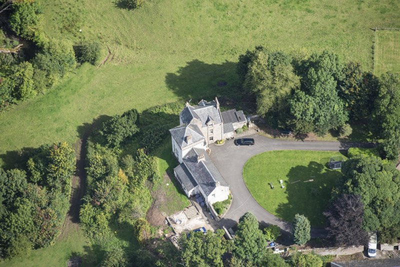 Oblique aerial view of Peel Tower House, looking NE.