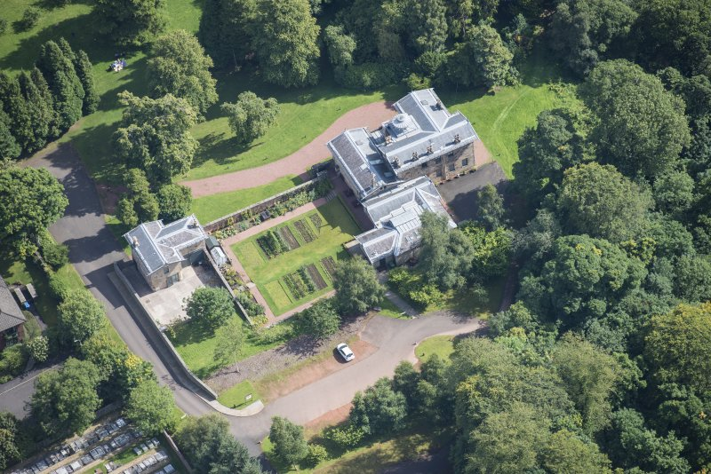 Oblique aerial view of Holmwood House, looking E.