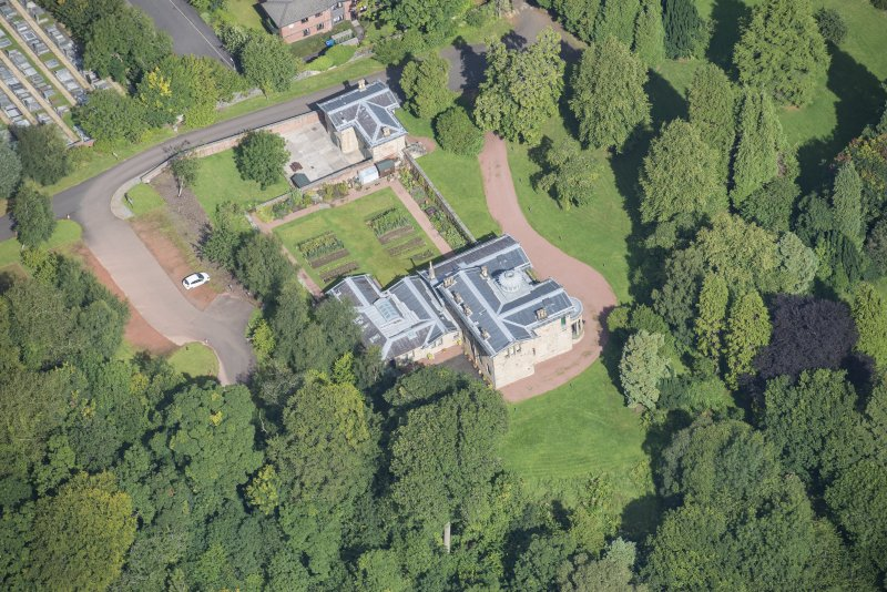 Oblique aerial view of Holmwood House, looking N.