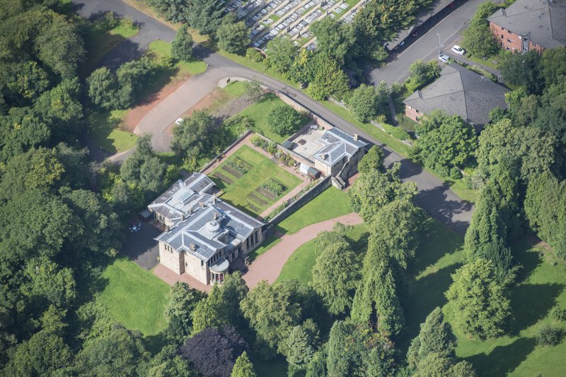 Oblique aerial view of Holmwood House, looking W.