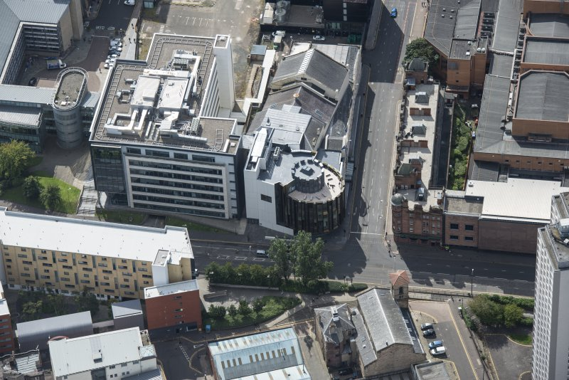 Oblique aerial view of the Theatre Royal, looking S.