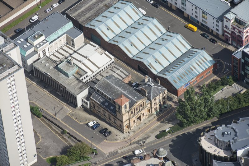 Oblique aerial view of Cowcaddens Free Church and Scottish Ambulance Service, looking NE.