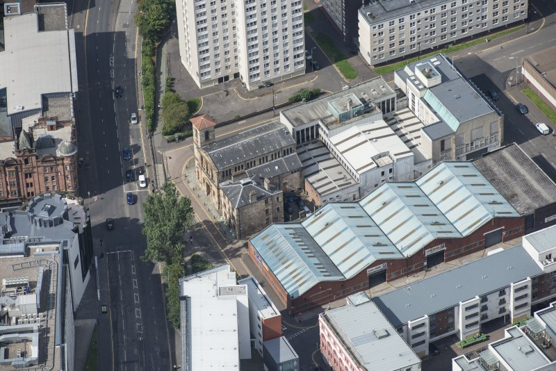 Oblique aerial view of Cowcaddens Free Church and Scottish Ambulance Service, looking NW.