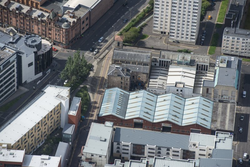 Oblique aerial view of Cowcaddens Free Church and Scottish Ambulance Service, looking WSW.