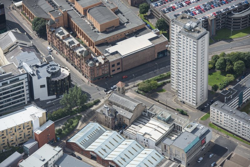 Oblique aerial view of Cowcaddens Free Church and Scottish Ambulance Service, looking SW.